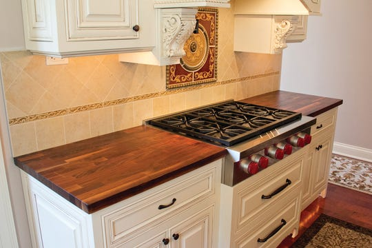 These John Boos and Co. American black walnut countertops are fabricated in an edge-grain fashion. This style is a fabrication made by using cut lumber planks, which are laid on edge and joined together.