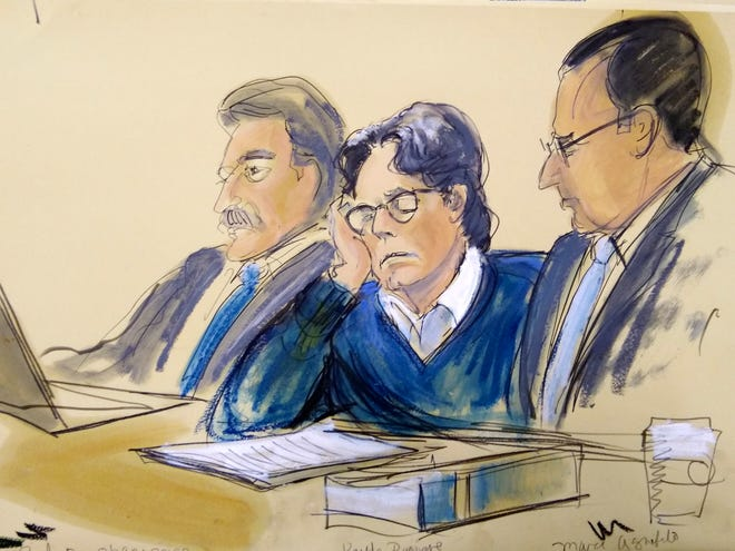 In this courtroom artist's sketch, defendant Keith Raniere, center, sits with attorneys Paul DerOhannesian, left, and Marc Agnifilo during closing arguments at Brooklyn federal court, Tuesday, June 18, 2019 in New York.