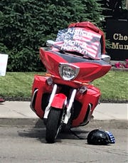 A motorcycle showing support for accident victims Mathew and Harolyn Matteson was parked outside the Chemung County Courthouse on Wednesday.
