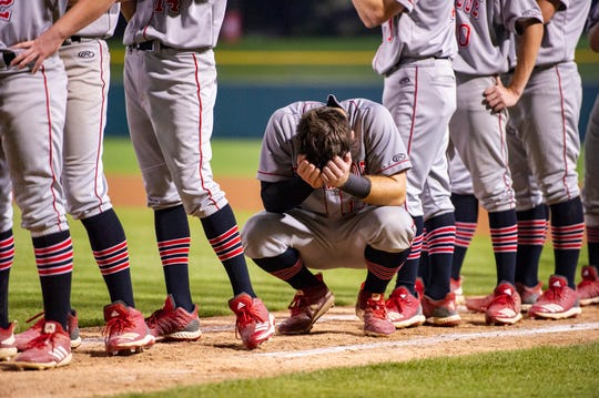 Southridge High School sophomore Chase Taylor (17) reflects on the team's loss after the 53rd Annual IHSAA Class 2A Baseball State Finals, Tuesday, June 18, 2019, at Victory Field in Indianapolis. Alexandria-Monroe High School won the game 4-3.