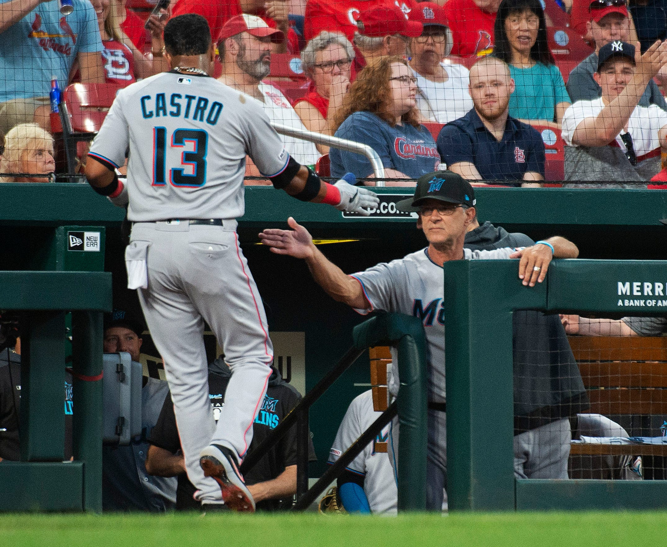 Miami Marlins manager Don Mattingly, right congratulates Starlin Castro after he hit a home run during the fifth inning of the team's baseball game against the St. Louis Cardinals, Tuesday, June 18, 2019, in St. Louis. (AP Photo/L.G. Patterson)