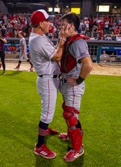 Southridge High School head coach Gene Mattingly talks with sophomore catcher Chase Taylor (17) immediately after the team's loss in the 53rd Annual IHSAA Class 2A Baseball State Finals, Tuesday, June 18, 2019, at Victory Field in Indianapolis. Alexandria-Monroe High School won the game 4-3.