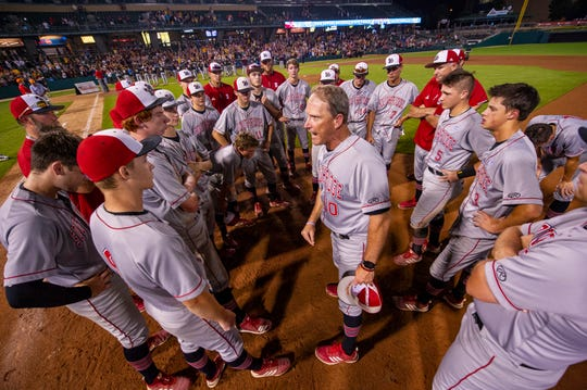 """Southridge High School head coach Gene Mattingly talks to the team about their loss, reminding them that it is """"just a game"""" after the 53rd Annual IHSAA Class 2A Baseball State Finals, Tuesday, June 18, 2019, at Victory Field in Indianapolis. Alexandria-Monroe High School won the game 4-3."""