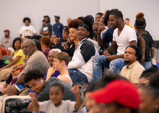 The Dust Bowl crowd gets some added entertainment between basketball games as 5-year-old Jah'meir Mockobee dances on the sidelines at the C.K. Newsome Center Tuesday evening.