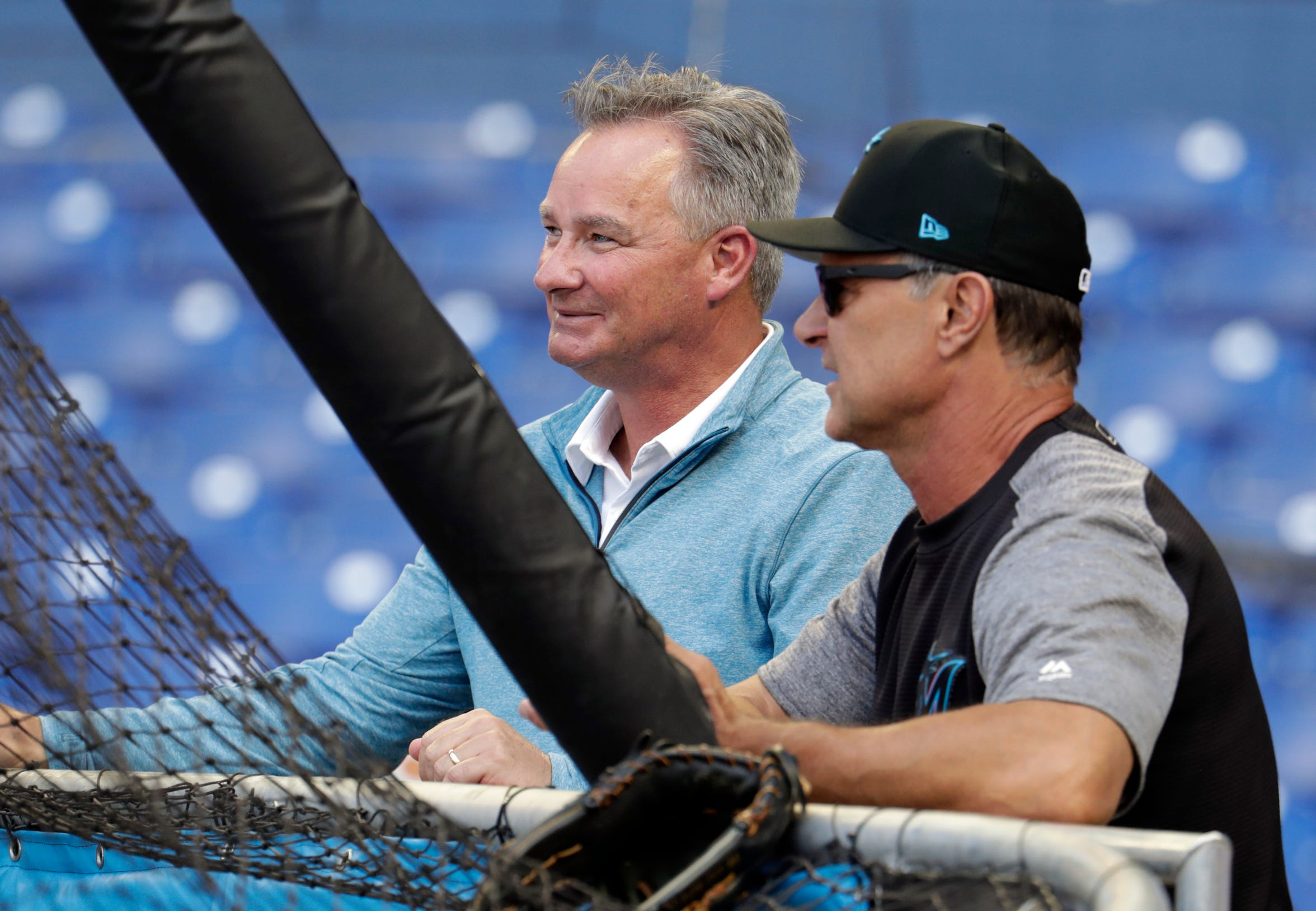 Miami Marlins' Gary Denbo, vice president for player development and scouting, left, stands with manager Don Mattingly before a baseball game against the San Francisco Giants, Wednesday, May 29, 2019, in Miami. (AP Photo/Lynne Sladky)