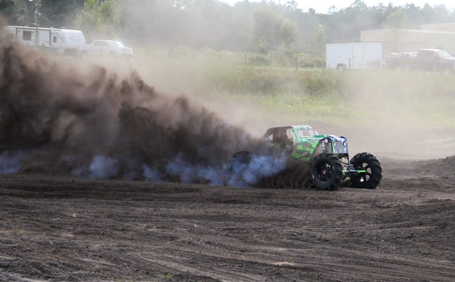 """Fort Myers racer Chris Libak drives his mega truck Animalistic during an episode of the TV series """"Dirty Mudder Truckers."""""""