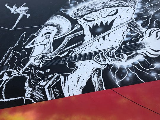 Pizza goes punk rock in this scene from Cleveland artist Jake Kelly's new mural outside Nice Guys Pizza in Cape Coral.