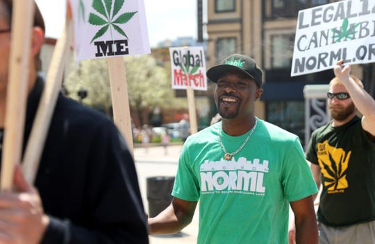 Alan Robinson, executive director of NORML Wisconsin, marches around the State Capitol in Madison, Wis., on May 4, 2019, as part of a pro-marijuana legalization rally. Robinson is among the thousands of state residents who use marijuana, which is illegal for both recreational and medicinal uses in Wisconsin.