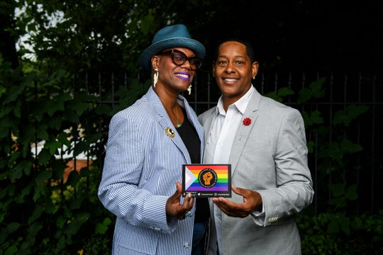 Upstate Pride SC Vice President Caroline Caldwell, left, and diversity officer Terena Starks, pose for a portrait while holding a card for Upstate Pride South Carolina Tuesday, June 18, 2019.