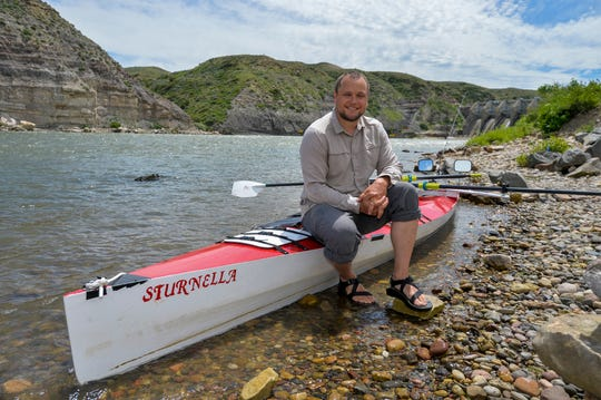Mark Juras sits on his custom built sculling row boat, the Sturnella, below Morony Dam June 19, 2019.  He intends to travel the length of the Missouri River with the goal of reaching the Mississippi River and ultimately the Gulf of Mexico.  He started his journey at the headwaters of the Missouri near Three Forks, Montana on June 8th, and hopes to row an average of 40 miles per day, calculating his total journey will take three months.