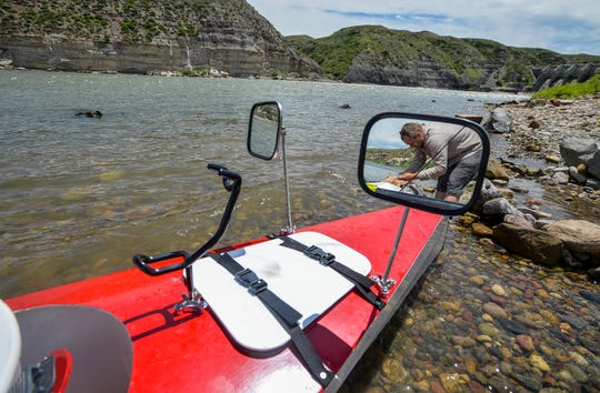 Mark Juras packs his custom built sculling row boat, the Sturnella, below Morony Dam on Wednesday afternoon, June 19, 2019. He intends to travel the length of the Missouri River with the goal of reaching the Mississippi River and ultimately the Gulf of Mexico.  He started his journey at the headwaters of the Missouri near Three Forks, Montana on June 8th, and hopes to row an average of 40 miles per day, calculating his total journey will take three months.