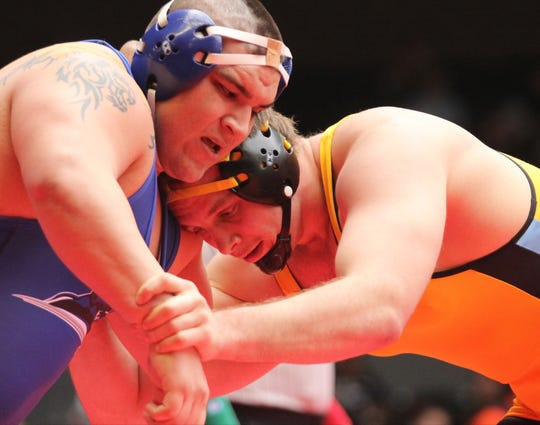 UGF heavyweight Jonathan Sears Tiernan, right, competes at the NAIA National Wrestling Meet in Des Moines, Iowa.