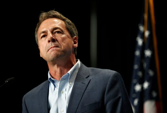 In this June 9, 2019 photo, Democratic presidential candidate Steve Bullock speaks during the Iowa Democratic Party's Hall of Fame Celebration in Cedar Rapids, Iowa.  Jane Fonda is joining a group of Hollywood power players to host a fundraiser for Democratic presidential contender Steve Bullock.  (AP Photo/Charlie Neibergall)