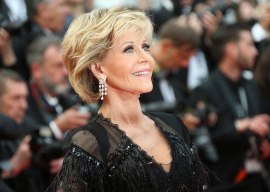 FILE - In this May 13, 2018 file photo, actress Jane Fonda poses for photographers upon arrival at the premiere of the film 'Sink or Swim' at the 71st international film festival, Cannes, southern France. Jane Fonda is joining a group of Hollywood power players to host a fundraiser for Democratic presidential contender Steve Bullock. (Photo by Joel C Ryan/Invision/AP)
