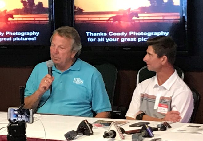 Owner Chester Thomas of Madisonville, left, talks to those in attendance during Wednesday's Ellis Park media day as jockey Corey Lanerie looks on.