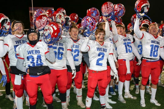 Western Boone celebrate their 19-7 victory over Scecina in the Class 2A Regional Championship, November 9, 2018.
