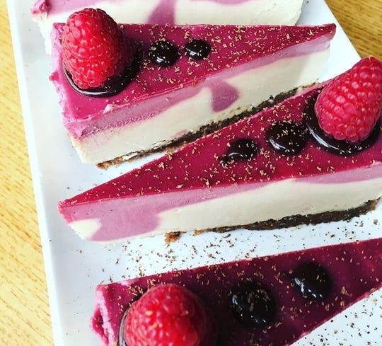 "Raw, dairy-free raspberry ""cheezecake"" as Ezra's Enlightened Cafe in the Broad Ripple area of Indianapolis."