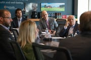 Gustavo Escalante (middle right), Indy Chamber hispanic business council manager, alongside other Chamber staff and Hispanic Business Council members, meet inside the Indy Chamber's office inside Salesforce Tower in Indianapolis on Wednesday, June 19, 2019.