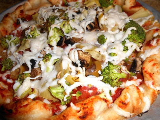Vegan pizza: WB Pizza, 6165 Allisonville Rd. makes one with no animal products of any kind in the dough or sauce,19 veggie choices, 2 herbs and Teese vegan cheese.