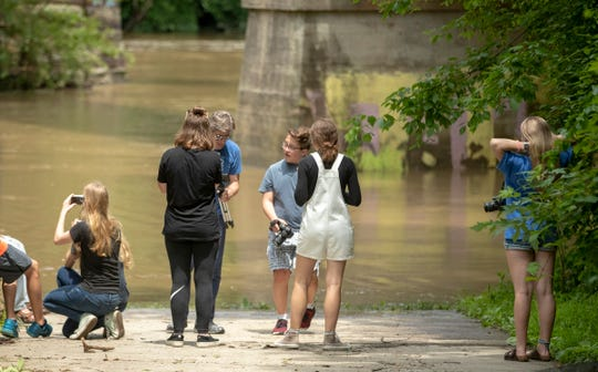 A photography class takes a look at the water on a day where the flow of the White River is about ten times the historic average for this day, Wednesday, June 19, 2019. An unusually wet Spring has made boating conditions extremely hazardous for much of the White River.
