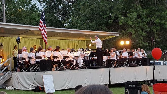 Members of the Iowa City Community Band relish the chance to play outdoors in front of engaged audiences.