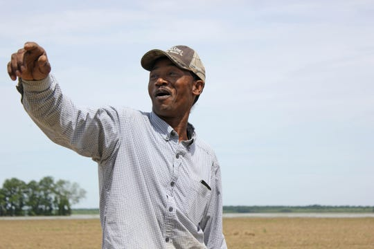 Under normal circumstances, Ollie Tate Jr. and other farm workers would be busy tending to fields of soybeans, corn and cotton. However, with all of the surrounding farmland under several feet of water, farming hasn't been an option this year. Tuesday, June 11, 2019.