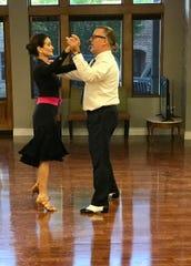 Anthony Thomas and Cassandra Walter dance together a Gotham Dance Club in Ridgeland.