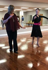 Allison Lowther of Madison, left, works to perfect a dance step with help from Cassandra Walter of Ridgeland.