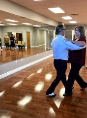 Gotham Dance Club owner Anthony Thomas dances with Allison Lowther of Madison during a group class.