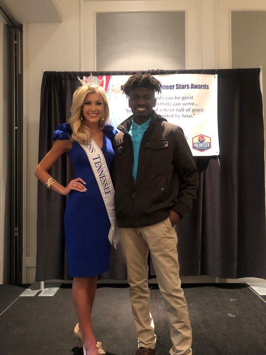 Everett Charles, a 2019 North Side High School graduate and the recipient of the National Consumers League service award, stands with 2018 Miss Tennessee Volunteer Christine Williamson.