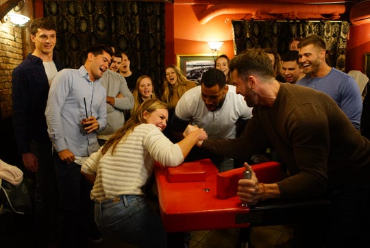 """Hannah Brown and Knoxville's Jed Wyatt arm wrestle on an episode of """"The Bachelorette."""""""