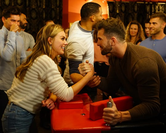 "Hannah Brown and Knoxville's Jed Wyatt arm wrestle on an episode of ""The Bachelorette."""