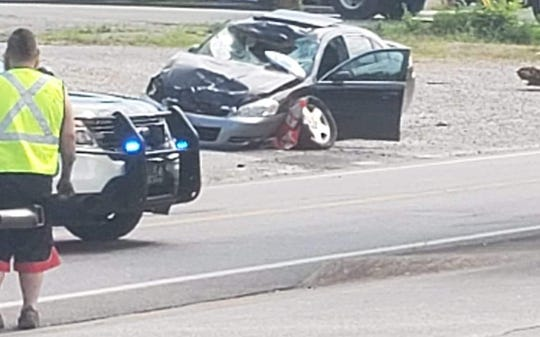 A photograph taken by a bystander shows a car that authorities say struck and killed pedestrian Darryl Butler along Sutherland Avenue at Harry Street in Knoxville on July 16, 2019.