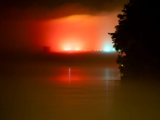 Fog covers the water near where a small plane crashed into the Tennessee river near the Knoxville Downtown Island Airport on Tuesday, June 18, 2019