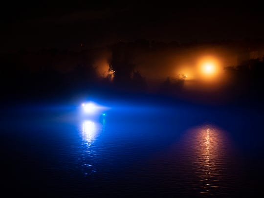 A Knoxville Police boat near where a small plane crashed into the Tennessee river near the Knoxville Downtown Island Airport on Tuesday, June 18, 2019