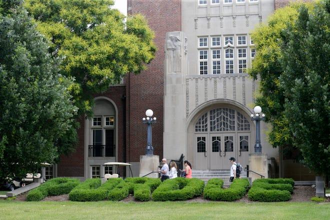 A group walks past Purdue University Memorial Union, Wednesday, June 19, 2019 in West Lafayette.