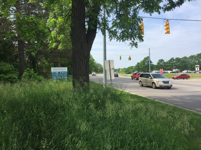 A for sale sign advertises 216 acres of vacant land at the intersection of D-19 and Interstate 96 in Howell, Wednesday, June 19, 2019.