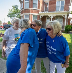 Jayme Fruit, second from left, and Joan Hoffman, hug as they meet at Zion United Church of Christ in Henderson. On far left is Cindy Evans and on far right is Lou Mahon. The women were among those supporting a new fairness ordinance in Henderson in 2019.