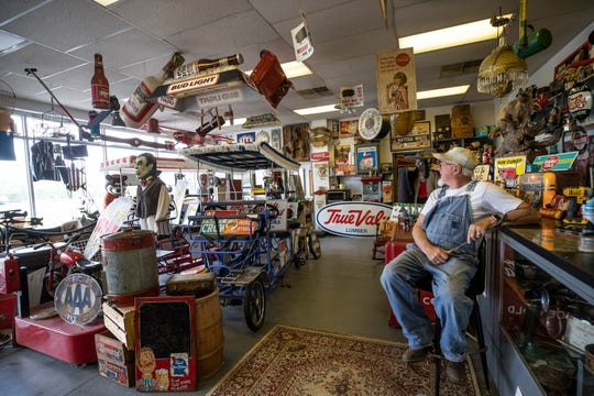 Mark Harris, owner of Rusty Roadside Relics, kept an eye on the flies that entered his shop in Henderson, Ky. June 19, 2019.