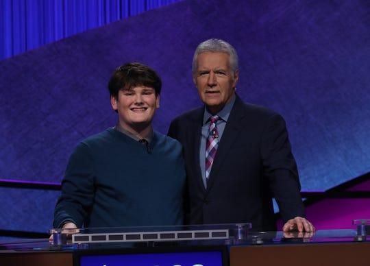 Jackson Jones with host Alex Trebek on Jeopardy.