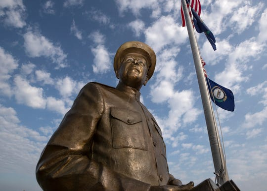 A statue honoring Admiral Husband Edward Kimmel stands at the waterfront in Henderson, Ky. June 19, 2019.