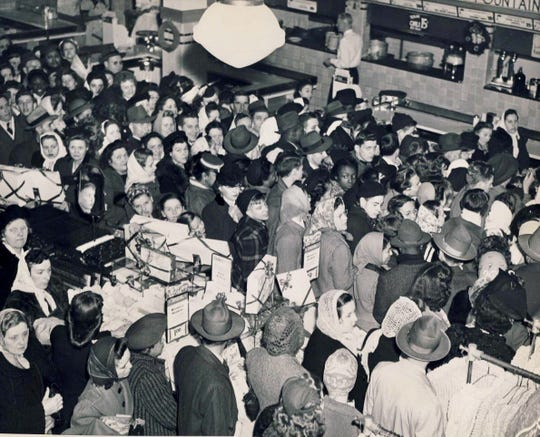 "A Christmas shopping ""riot"" is shown Dec. 15, 1945, at Grant's department store in downtown Louisvil"