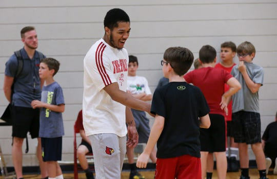 Louisville graduate transfer Fresh Kimble, left, greeted Brooks Baker during the Chris Mack Basketball Camp on U of L's campus.   June 19, 2019