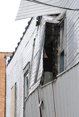 An outside wall buckled and was partially blown out two years ago at the site of a meth lab explosion March 2, 2013, in downtown Charlotte.