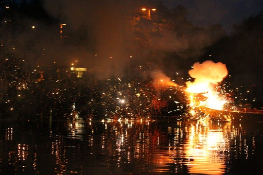 A photo taken from Ariniko O'Meara of fireworks that were shot along the Grand River in Lansing during an opening ceremony for the Capital City Dragon Boat Race.