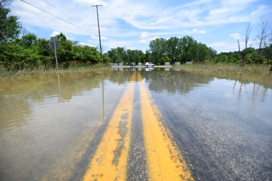 A portion of Ohio Route 96 at the Ohio 13 intersection was flooded still on Wednesday and closed to traffic.