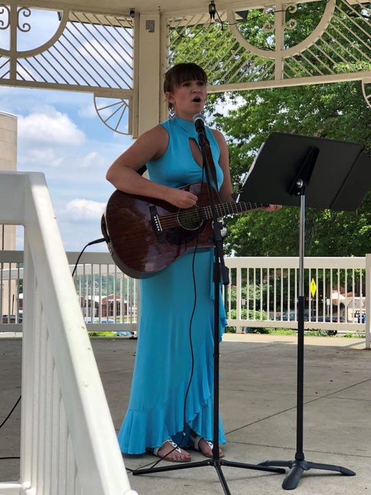 "Ellie Nickoli sings a cover version of Taylor Swift's ""Dear John"" in the Central Park gazebo on Wednesday for a free Picnic in the Park concert."