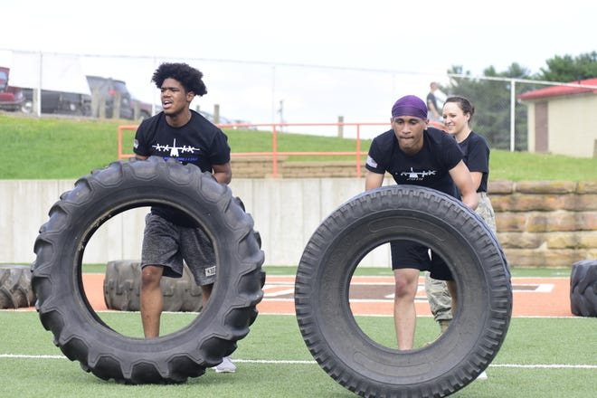 A pair of Mansfield Tygers flip tires on Arlin Field on Wednesday as part of the 179th Herc Challenge 2019.