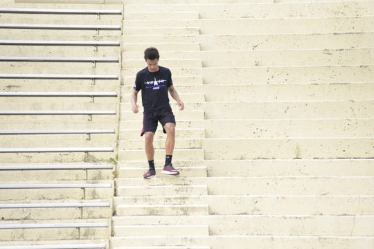 Andre Hill, a sophomore from Shelby, finishes the final stretch of stadium stairs Wednesday in Arlin Field before winning the 179th Herc Challenge 2019.
