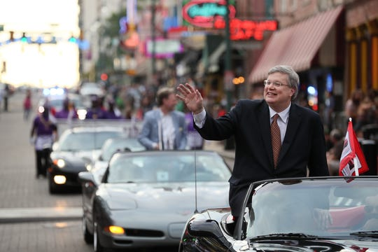 Mayor Jim Strickland rides down Beale Street for a parade in honor of the 180th birthday of Robert Church, famed  African-American entrepreneur, businessman and landowner who lived in Memphis, on Tuesday, June 18, 2019.